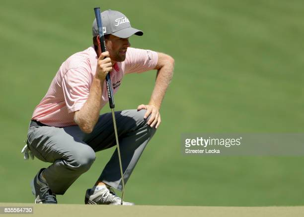 Webb Simpson lines up a putt on the first hole during the third round of the Wyndham Championship at Sedgefield Country Club on August 19 2017 in...