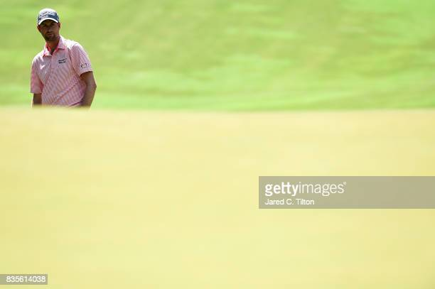 Webb Simpson looks on from the fifth fairway during the third round of the Wyndham Championship at Sedgefield Country Club on August 19 2017 in...