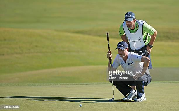 Webb Simpson looks over the ninth green with his caddie Paul Tesori during the third round of the Shriners Hospitals for Children Open at TPC...