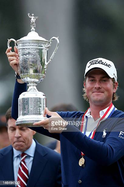 Webb Simpson of the United States celebrates with the trophy after his onestroke victory at the 112th US Open at The Olympic Club on June 16 2012 in...
