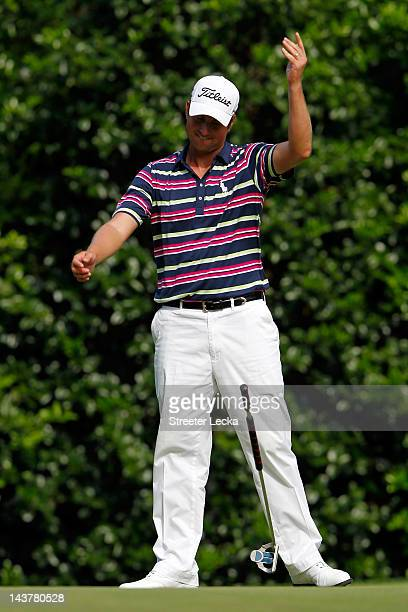 Webb Simpson of the United States drops his club in reaction to making a putt for birdie on the 12th hole during the first round of the Wells Fargo...