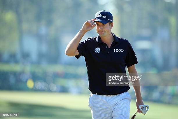 Webb Simpson of the United States makes birdie on the first hole during the first round of the 2014 Masters Tournament at Augusta National Golf Club...