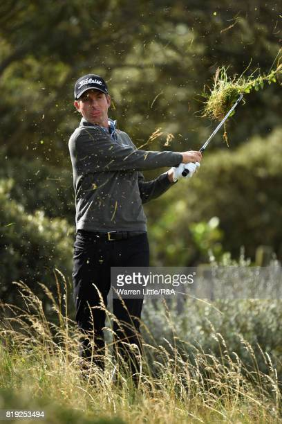 Webb Simpson of the United States plays out of the rough on the first hole during the first round of the 146th Open Championship at Royal Birkdale on...