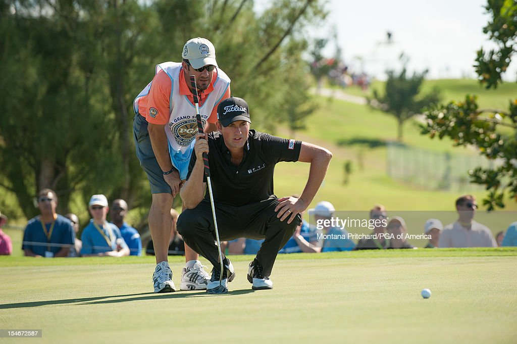 Webb Simpson of the US and his caddie read a putt during the final round of play at The Port Royal Golf Club for the 30th Grand Slam of Golf on October, 24, 2012 in Southampton, Bermuda.