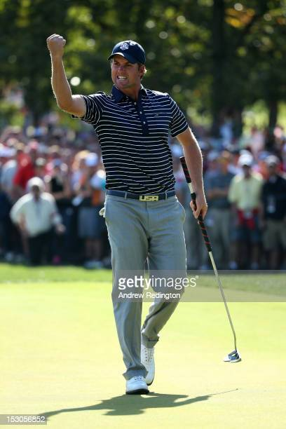 Webb Simpson of the USA celebrates a putt on the 11th green during day two of the Afternoon FourBall Matches for The 39th Ryder Cup at Medinah...