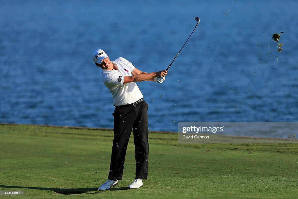 <a gi-track='captionPersonalityLinkClicked' href=/galleries/search?phrase=Webb+Simpson&family=editorial&specificpeople=4466575 ng-click='$event.stopPropagation()'>Webb Simpson</a> of the USA plays his second shot at the par 4, 18th hole during the second round of THE PLAYERS Championship held at THE PLAYERS Stadium course at TPC Sawgrass on May 11, 2012 in Ponte Vedra Beach, Florida.