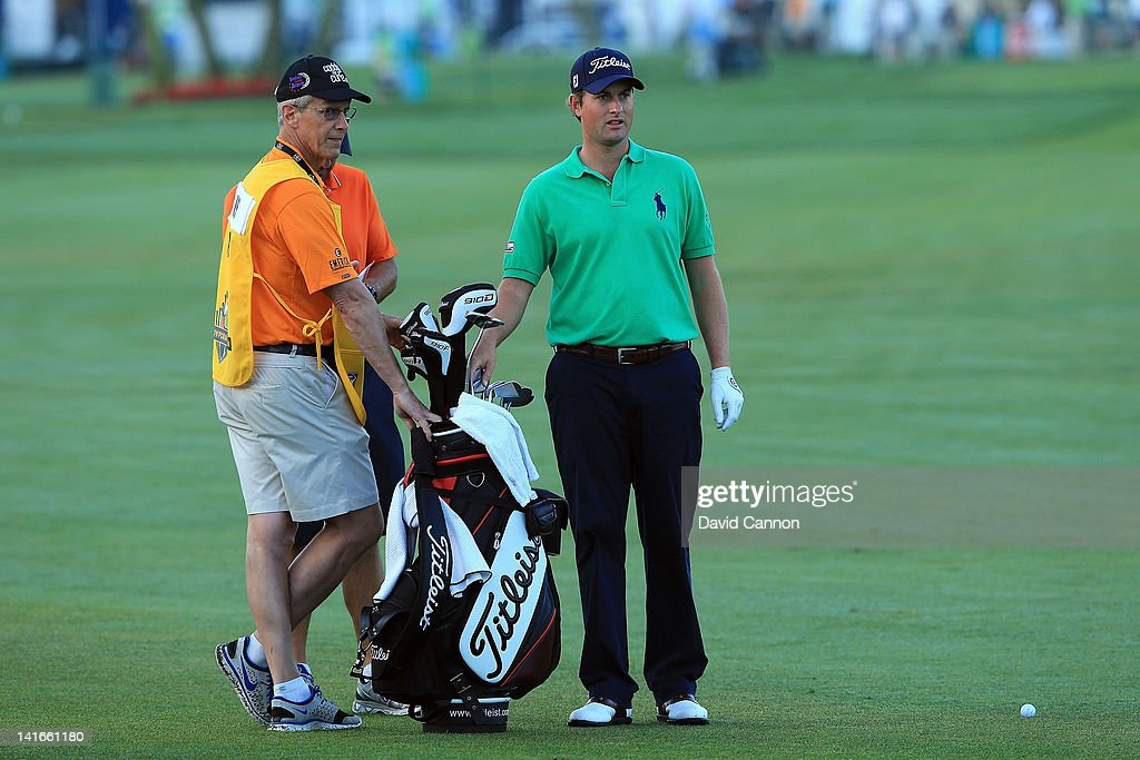 Webb Simpson of the USA working with a 'Caddie for a Cure' caddy during the pro-am as a preview for the 2012 Arnold Palmer Invitational presented by MasterCard at Bay Hill Club and Lodge on March 21, 2012 in Orlando, Florida.