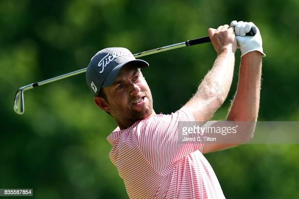 Webb Simpson plays his tee shot on the seventh hole during the third round of the Wyndham Championship at Sedgefield Country Club on August 19 2017...