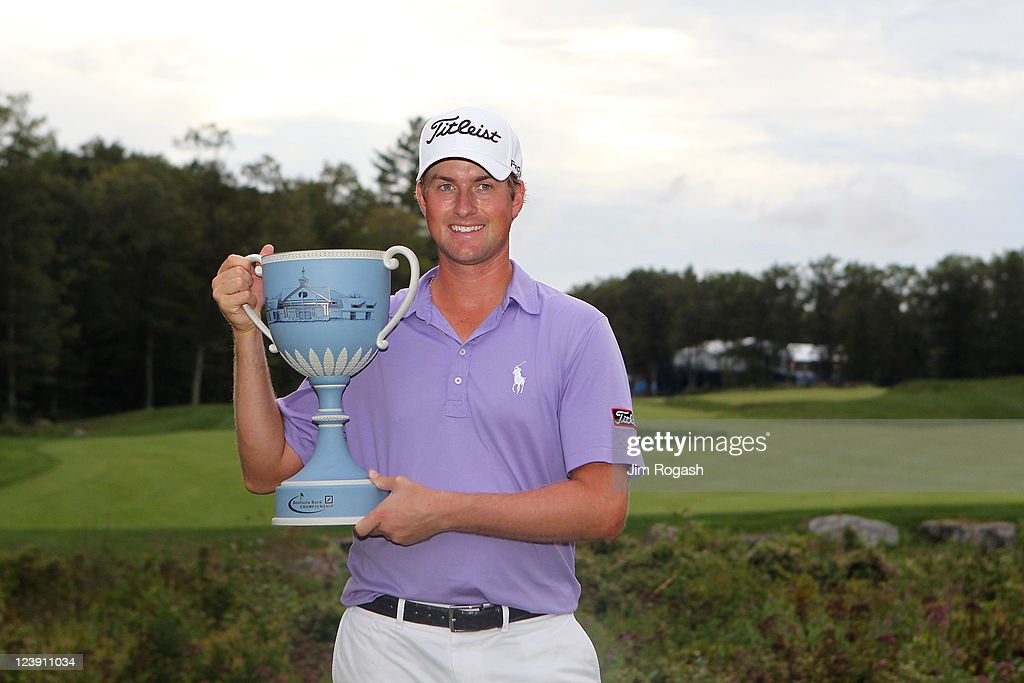 Webb Simpson poses with the trophy after he won thr tournament following the final round of the Deutsche Bank Championship at TPC Boston on September...