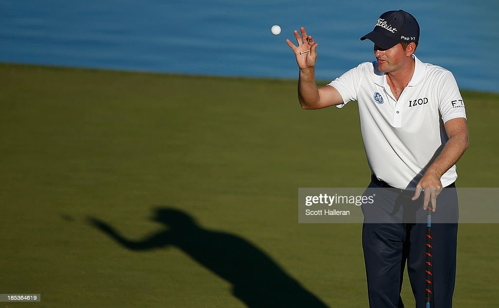 <a gi-track='captionPersonalityLinkClicked' href=/galleries/search?phrase=Webb+Simpson&family=editorial&specificpeople=4466575 ng-click='$event.stopPropagation()'>Webb Simpson</a> reaches for his golf ball on the 16th green during the third round of the Shriners Hospitals for Children Open at TPC Summerlin on October 19, 2013 in Las Vegas, Nevada.