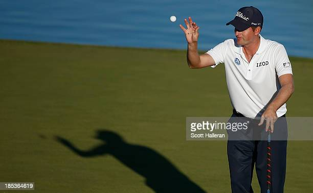 Webb Simpson reaches for his golf ball on the 16th green during the third round of the Shriners Hospitals for Children Open at TPC Summerlin on...