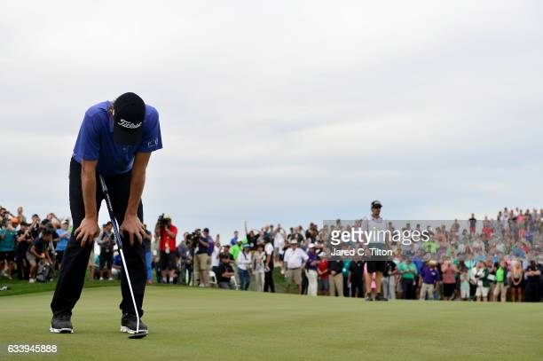 Webb Simpson reacts after missing his birdie putt on the third playoff hole on the 10th green during the final round of the Waste Management Phoenix...