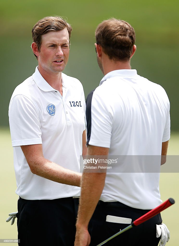 <a gi-track='captionPersonalityLinkClicked' href=/galleries/search?phrase=Webb+Simpson&family=editorial&specificpeople=4466575 ng-click='$event.stopPropagation()'>Webb Simpson</a> (L) shakes hands with <a gi-track='captionPersonalityLinkClicked' href=/galleries/search?phrase=Dustin+Johnson&family=editorial&specificpeople=3908453 ng-click='$event.stopPropagation()'>Dustin Johnson</a> on the 18th green following the continuation of the second round of the FedEx St. Jude Classic at the TPC Southwind on June 7, 2014 in Memphis, Tennessee.