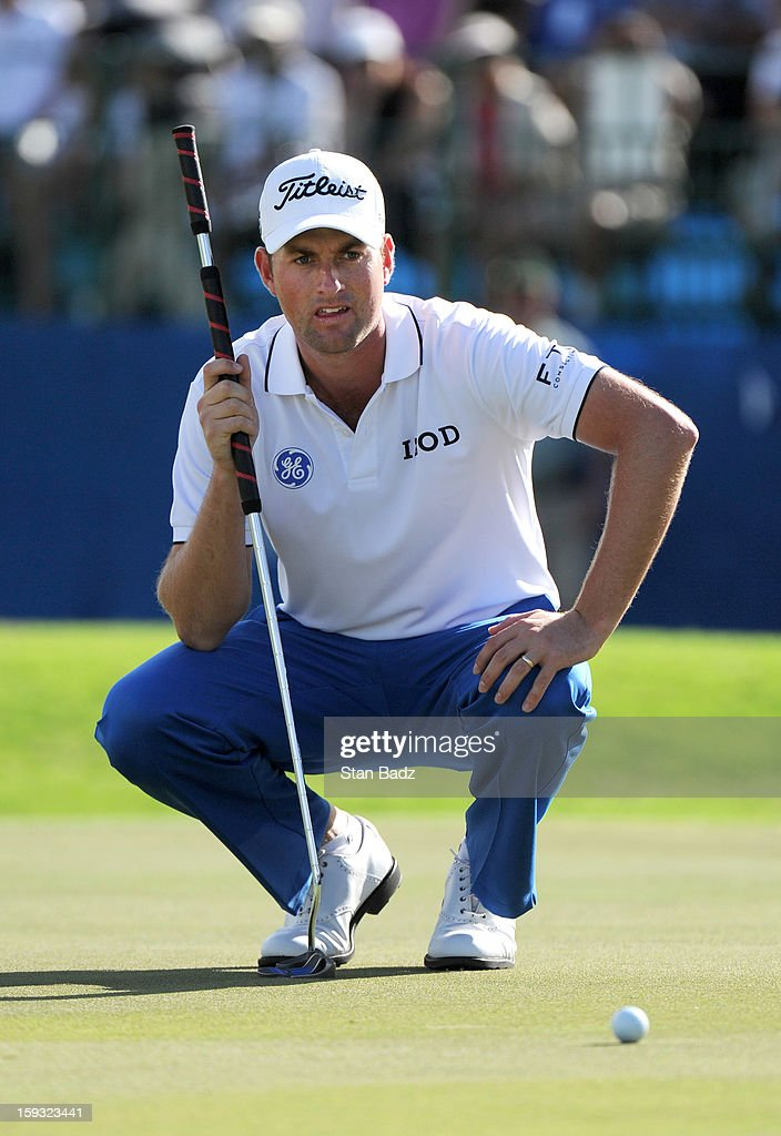 Webb Simpson studies his putt on the 18th green during the second round of the Sony Open in Hawaii at Waialae Country Club on January 11, 2013 in Honolulu, Hawaii.