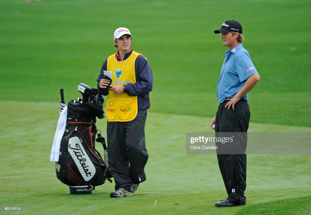 Webb Simpson talks with his caddie on the first hole during the third round of The Barclays at Liberty National Golf Club on August 29 2009 in Jersey...