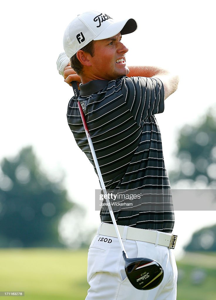 <a gi-track='captionPersonalityLinkClicked' href=/galleries/search?phrase=Webb+Simpson&family=editorial&specificpeople=4466575 ng-click='$event.stopPropagation()'>Webb Simpson</a> tees off on the 18th hole during the third round of the 2013 Travelers Championship at TPC River Highlands on June 22, 2012 in Cromwell, Connecticut.