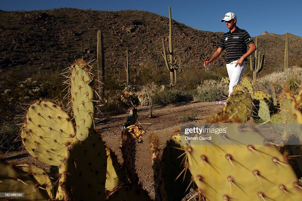 Webb Simpson walks between 15 green and 16 tee during the quarterfinal round of the World Golf Championships - Accenture Match Play at the Golf Club at Dove Mountain on February 23, 2013 in Marana, Arizona.