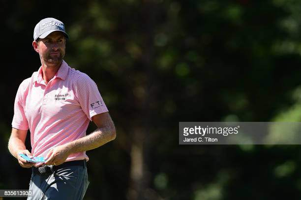 Webb Simpson walks to the fifth tee during the third round of the Wyndham Championship at Sedgefield Country Club on August 19 2017 in Greensboro...
