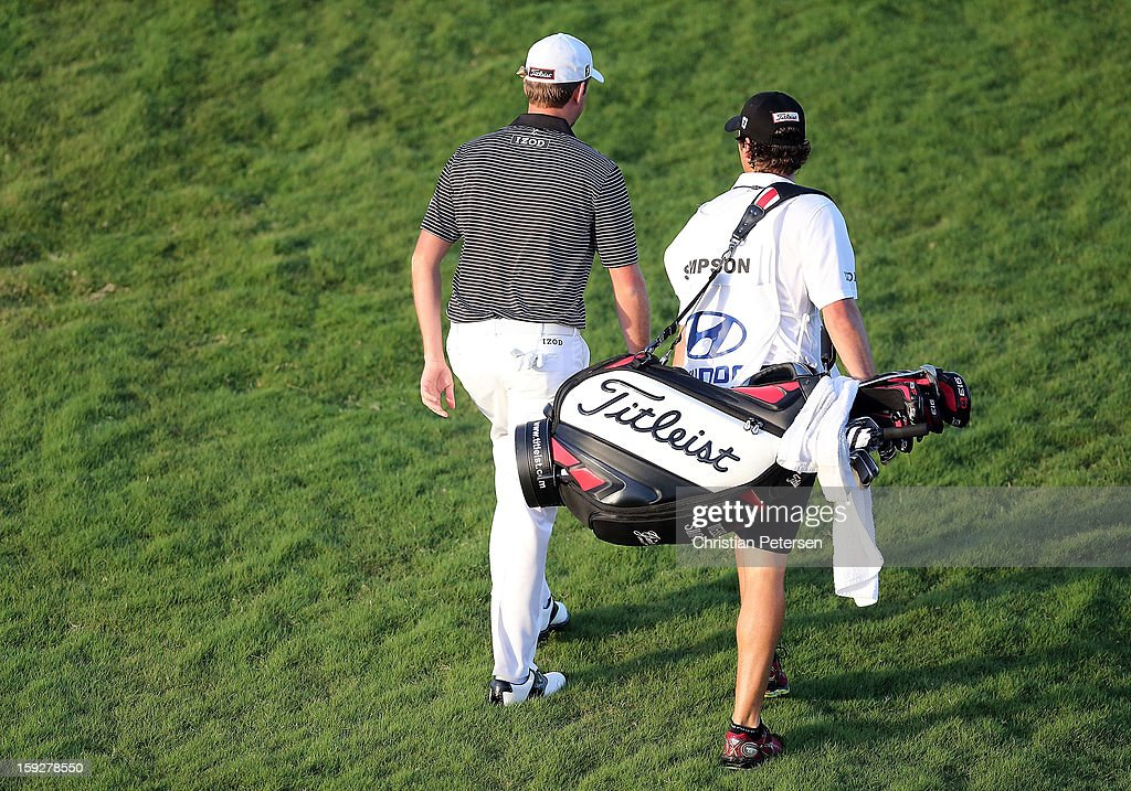 Webb Simpson walks with his caddie during the final round of the Hyundai Tournament of Champions at the Plantation Course on January 8, 2013 in Kapalua, Hawaii.