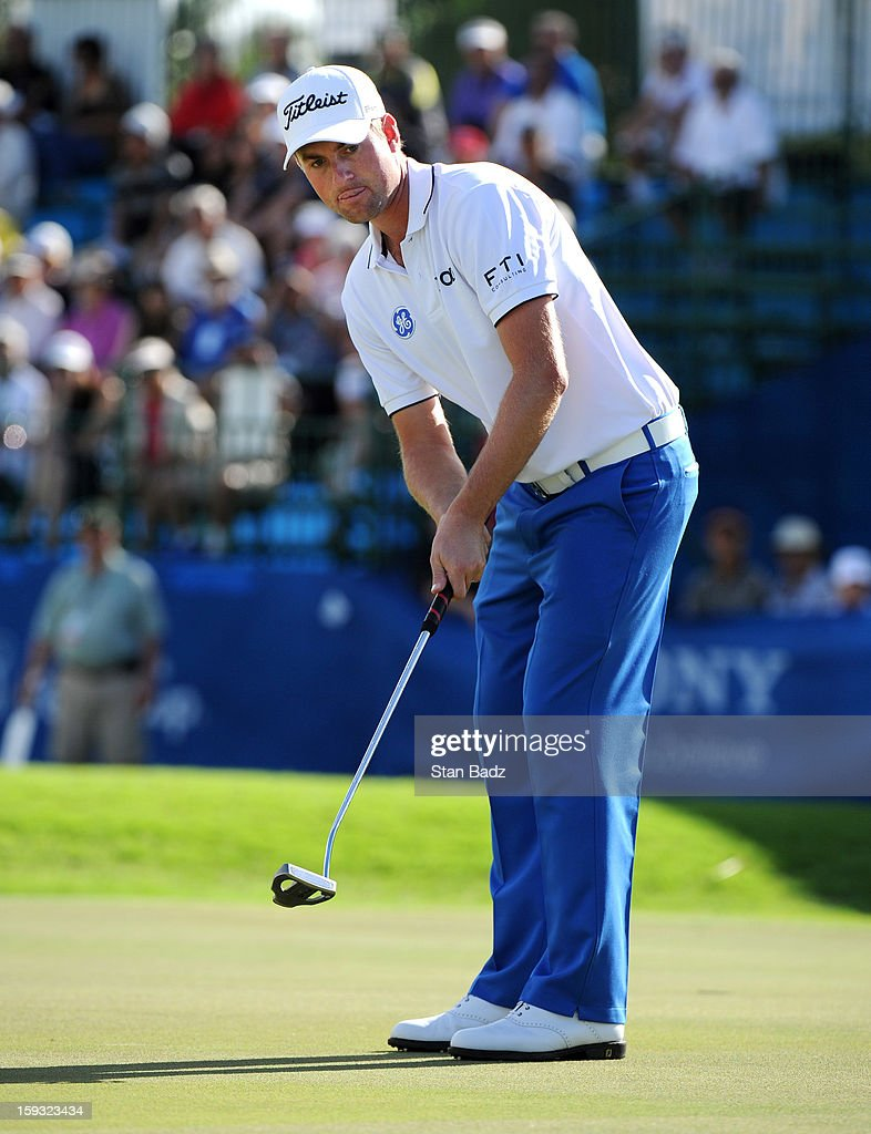 Webb Simpson watches his putt on the 18th green during the second round of the Sony Open in Hawaii at Waialae Country Club on January 11, 2013 in Honolulu, Hawaii.