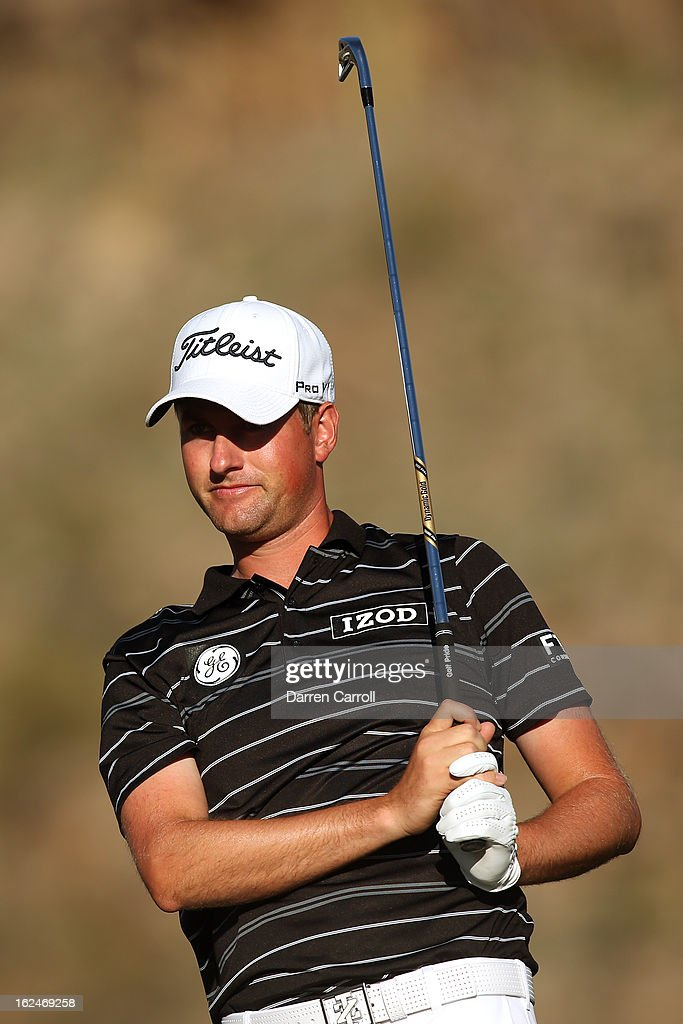 Webb Simpson watches his tee shot on the 16th hole during the quarterfinal round of the World Golf Championships - Accenture Match Play at the Golf Club at Dove Mountain on February 23, 2013 in Marana, Arizona.