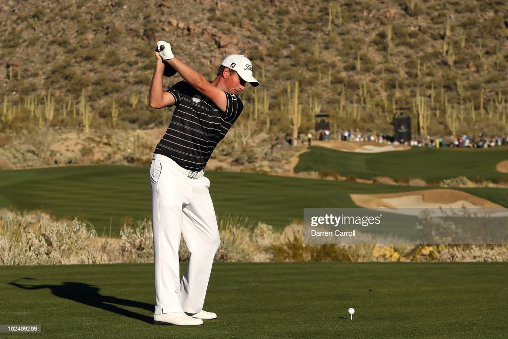 Webb Simpson watches his tee shot on the 17th hole during the quarterfinal round of the World Golf Championships - Accenture Match Play at the Golf Club at Dove Mountain on February 23, 2013 in Marana, Arizona.