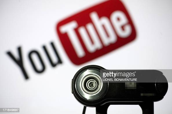 A webcam is positioned in front of YouTube's logo on June 28 2013 in Paris A new type of crook hunts its victims on the web pushing them to erotic...