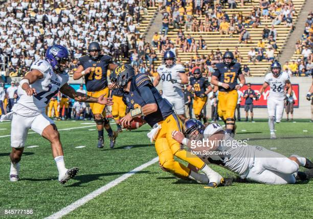 Weber State Wildcats defensive lineman Cardon Malan pulls down California Golden Bears quarterback Ross Bowers during the regular season game between...