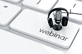3d render of microphone with headphones on the keyboard. Webinar concept