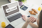 Webinar online, internet education, e-learning concept. Woman watching e-learning content on laptop