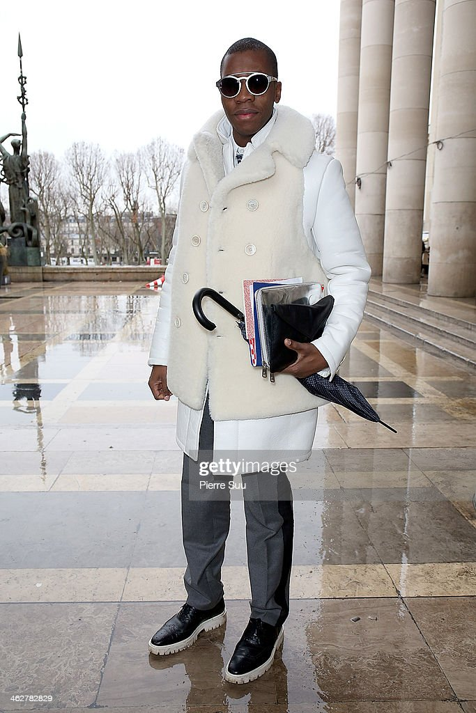 Webmaster Florian wears Givenchy Coat,Lanvin Pants,Burberry Shoes,Armani bag,Alexander Mc Queen ipad sleeve on January 15, 2014 in Paris, France.