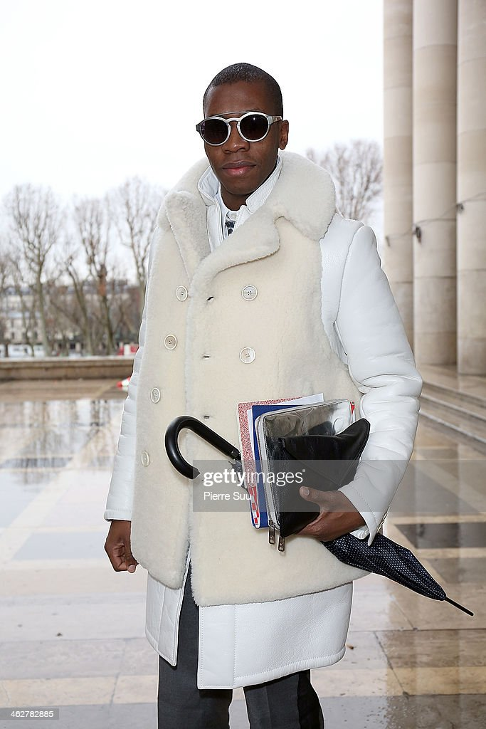 Webmaster Florian wears Givenchy Coat,Lanvin Pants,Burberry,Armani bag,Alexander Mc Queen ipad sleeve on January 15, 2014 in Paris, France.