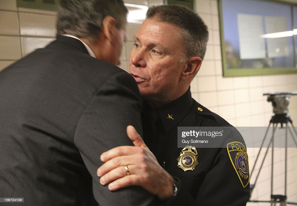 Webster Police Chief Gerald Pickering (R) embraces New York State Lt. Gov. Robert Duffy following a news conference concerning the two firefighters killed, and two injured in a presumed ambush attack December 24, 2012 in Webster, New York. Authorities say an ex-con gunned down two firefighters after setting a car and a house on fire early Monday, then took shots at police and committed suicide while several homes burned.
