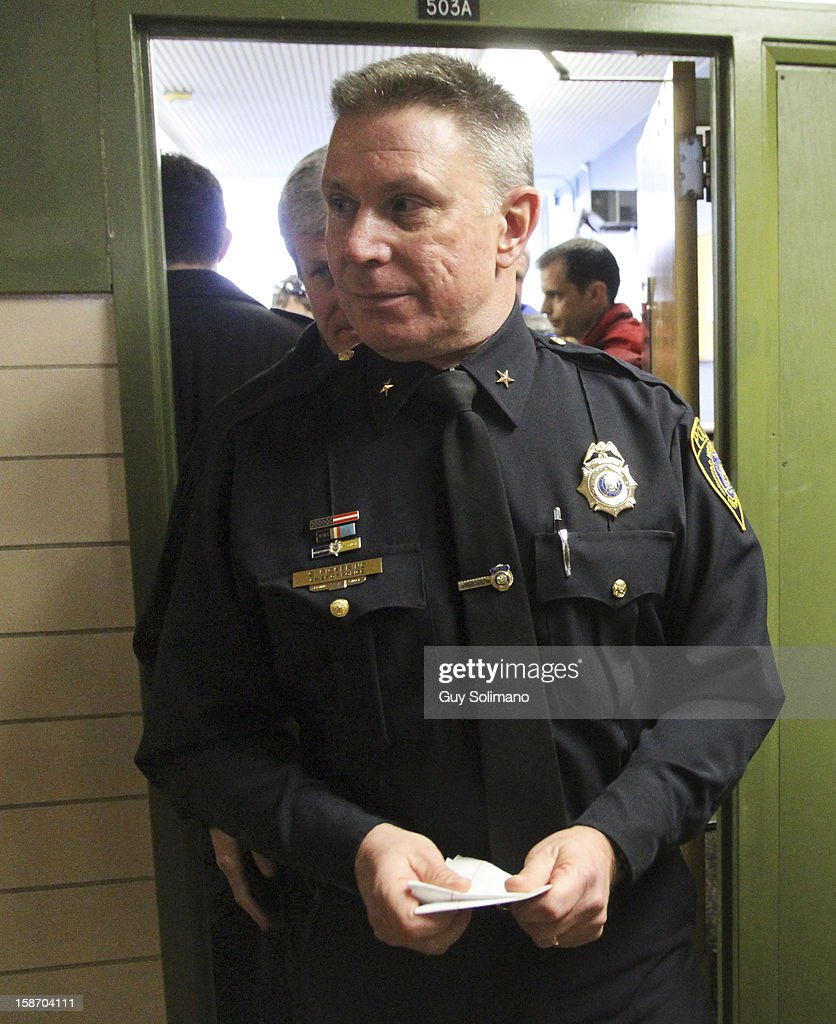 Webster Police Chief Gerald Pickering exits a news conference concerning the two firefighters killed, and two injured in a presumed ambush attack December 24, 2012 in Webster, New York. Authorities say an ex-con gunned down two firefighters after setting a car and a house on fire early Monday, then took shots at police and committed suicide while several homes burned.