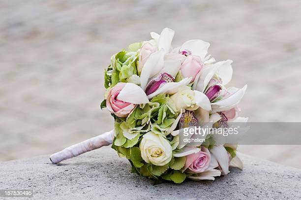 Wedding Bouquet laying on stone block