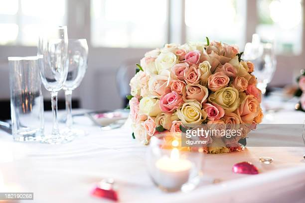 A wedding bouquet on a wedding reception table
