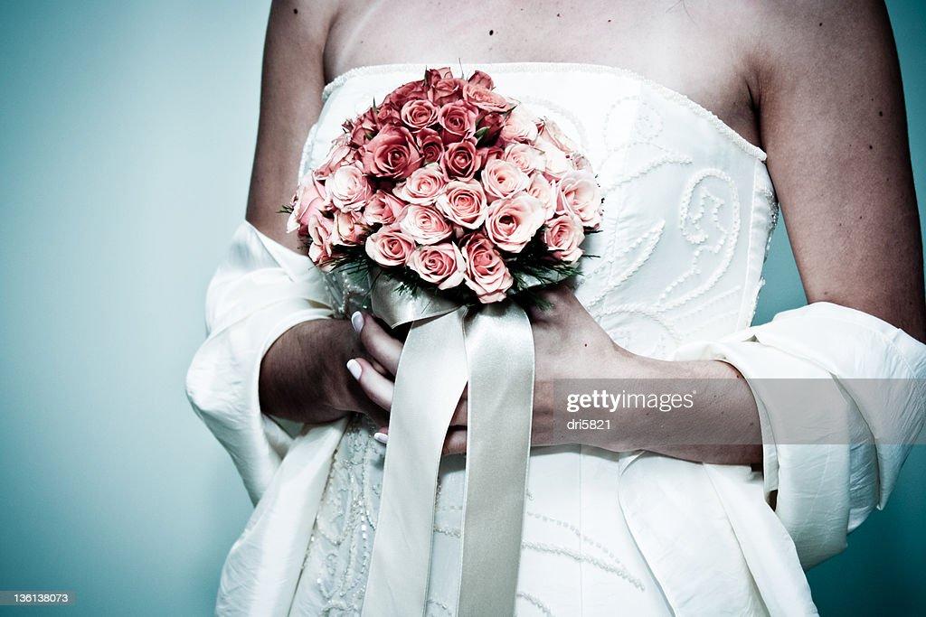 Wedding bride with flower bouquet : Stock Photo