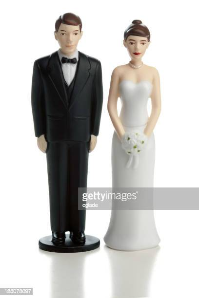 Wedding cake bride and groom statuettes on white