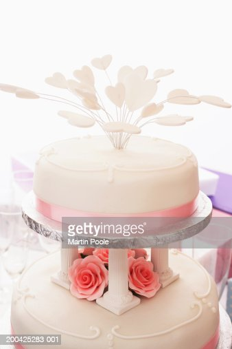 Wedding cake decorated with iced hearts, close-up : Stock Photo