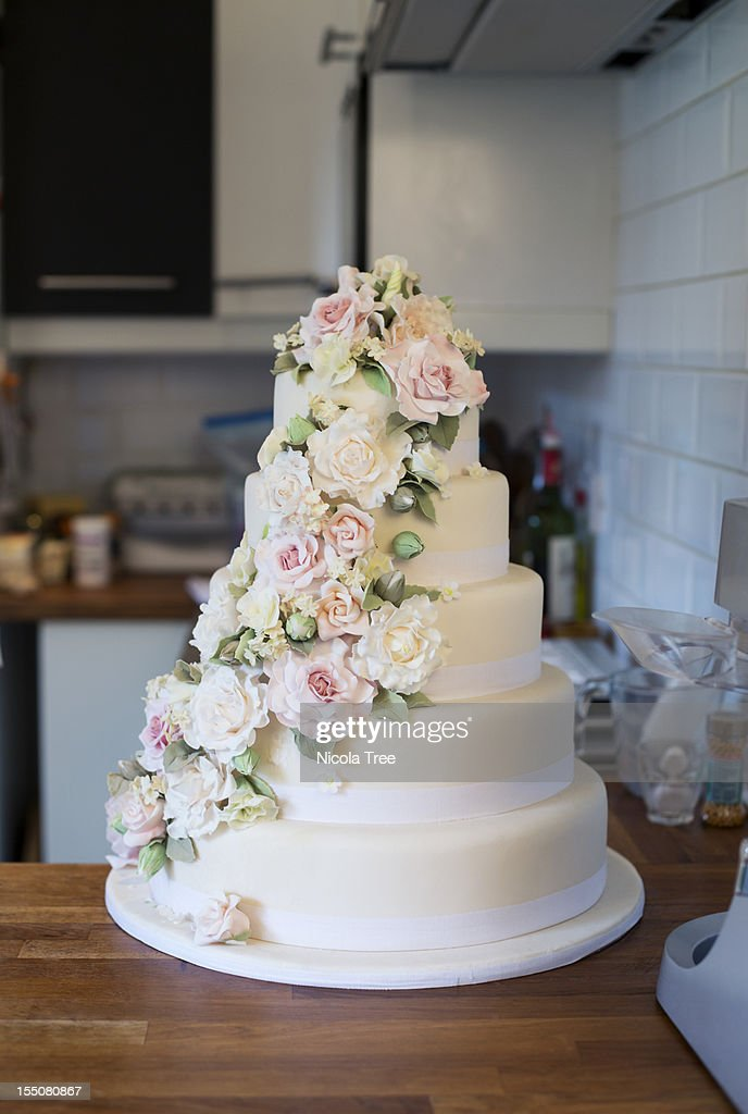 Wedding cake iced and decorated. : Stock Photo