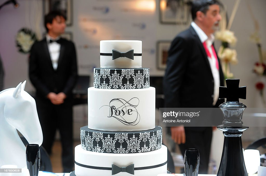 A wedding cake is displayed beside oversized chess pieces at the gay marriage show on April 27, 2013 in Paris, France. The show takes place four days after France legalised same-sex marriage at the National Assembly.