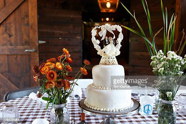 Wedding cake on table in barn at country wedding