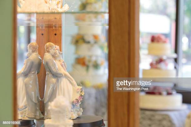 LAKEWOOD CO SEPT Wedding cake toppers and other wedding related items and display cakes on display in Masterpiece Cakeshop in Lakewood CO on Thursday...