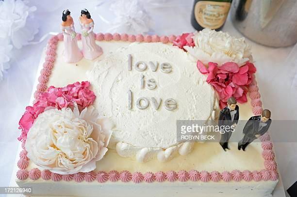 A wedding cake with a groom couple and a bride couple is seen at The Abbey restaurant at a celebration of the over100 samesex marriages performed...