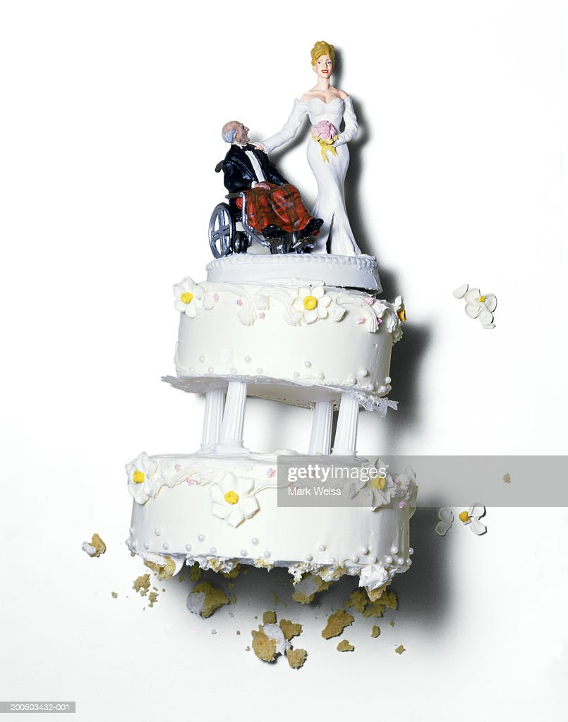 Wedding cake with buxom bride and old groom : Stock Photo