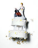 Wedding cake with buxom bride and old groom
