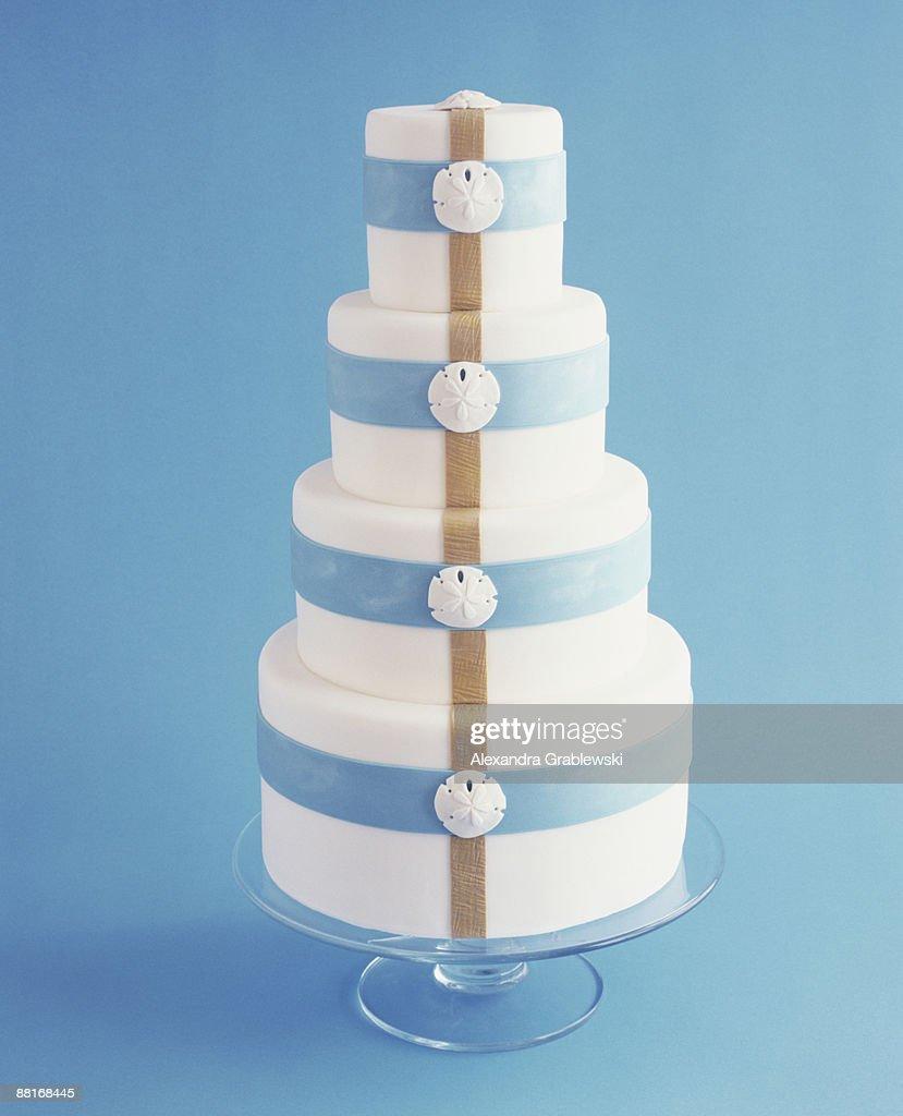 Wedding cake with sand dollars