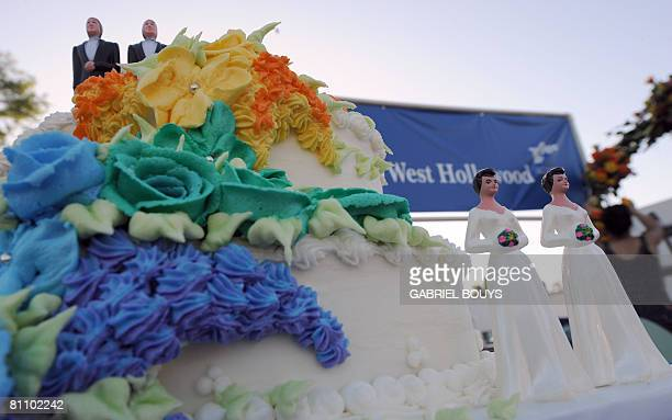 A wedding cake with statuettes of two men and two women is seen during the demonstration in West Hollywood California May 15 after the decision by...
