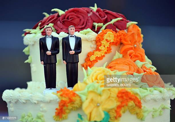 A wedding cake with statuettes of two men is seen during the demonstration in West Hollywood California May 15 after the decision by the California...