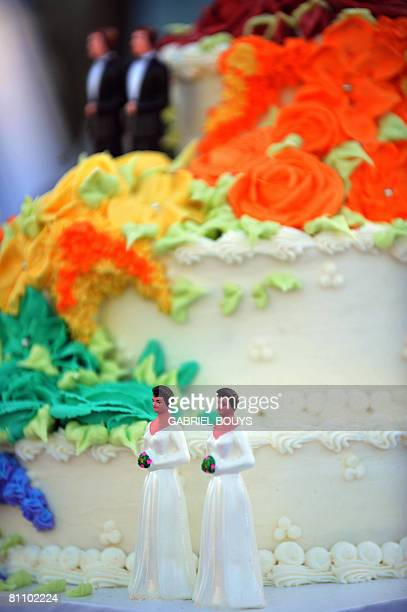 A wedding cake with statuettes of two women and two men is seen during the demonstration in West Hollywood California May 15 after the decision by...